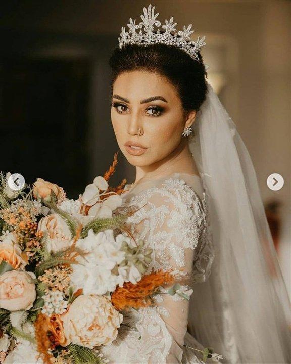 بفستان السندريلا.. إطلالة أنيقة لـ البلوجر مي إبراهيم في حفل زفافها.. شاهد
