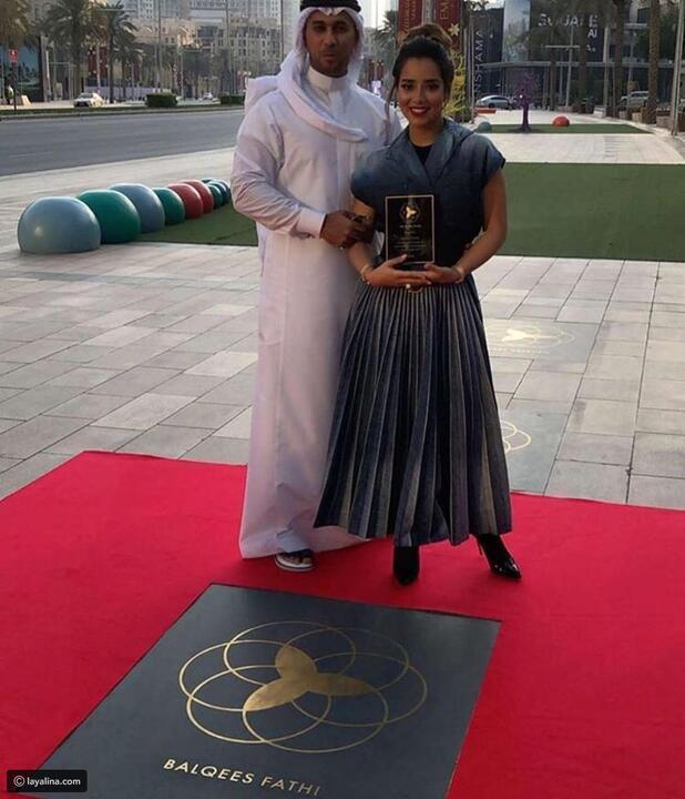 بلقيس فتحي تحتفل بنجمتها الخاصة في ممشى دبي للمشاهير بإطلالتين من Dior