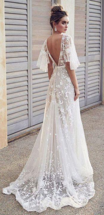 شاهدي أروع الاطلالات الكلاسيكية لفساتين زفاف صيف 2019